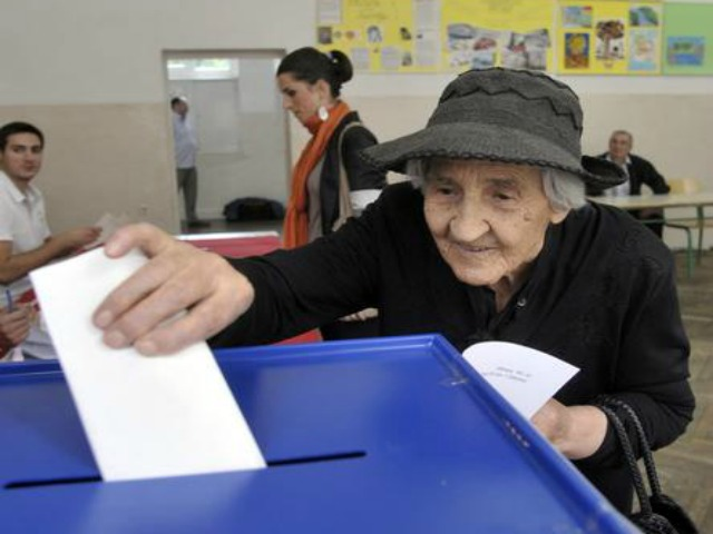 old lady with a hat voting
